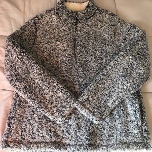 I'm selling a fuzzy quarter zip sweater.